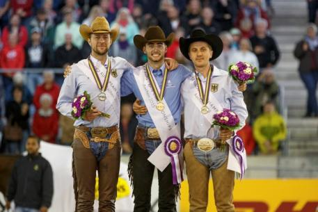 The individual medal podium at the FEI European Reining Championships (from left), silver medallist Grischa Ludwig (GER), gold medallist Giovanni Masi de Vargas (ITA), and bronze medallist Elias Ernst (GER).