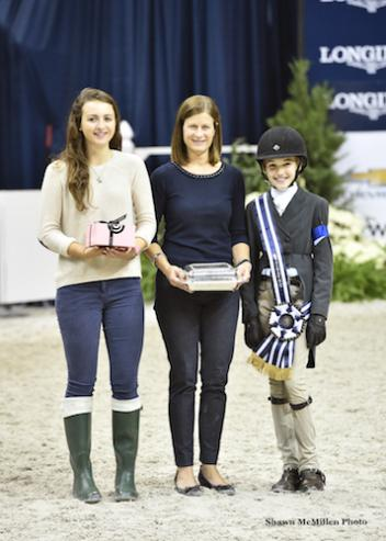 Farah Rizvi accepts the award for Best Child Rider on a Pony with WIHS Youth Ambassador Miriam Dupree and WIHS Executive Director Bridget Love Meehan