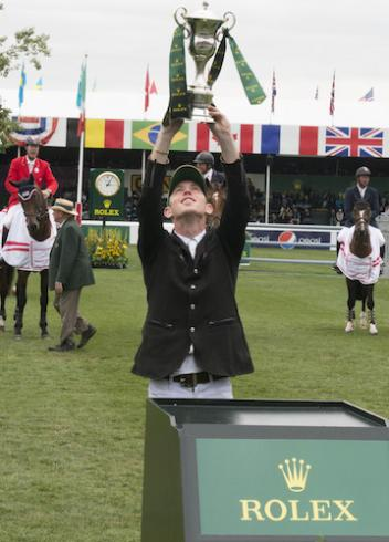 Scott Brash celebrates his win in the Rolex Grand Slam of Show Jumping