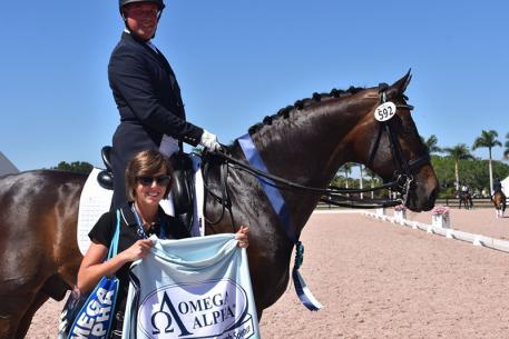 Scott Hassler and Diamo Gold receiving the Omega Alpha Healthy Horse Award during week ten of the Adequan Global Dressage Festival