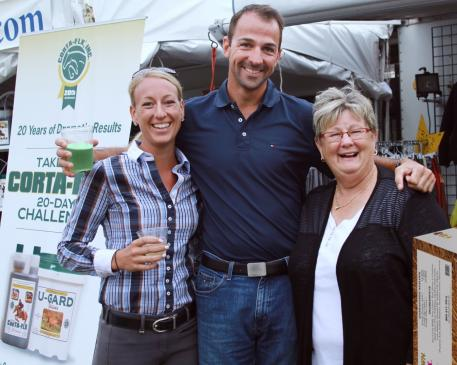 Trainers Shannon Stevens (left) Marcus Orlob (center) and Beth Haist (right) of The Horse of Course enjoy the celebration on the vendors green at the Adequan Global Dressage Festival show ground