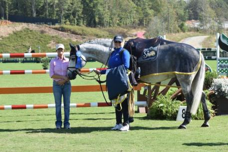 Sintija Dusele and Jeneret in their presentation ceremony for the $2,000 Southern Arches Grooms' Class with Winn Alden of Southern Arches.