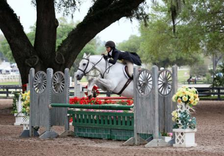Skyler Fields and Echo on their way to a $5,000 Platinum Performance Hunter Prix win.