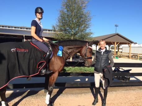 Stephanie Hartigan aboard Clever, with her husband Glenn Hartigan, won a blue ribbon in the Premier Equestrian 0.80m Low Jumper class at Tryon International Equestrian Center