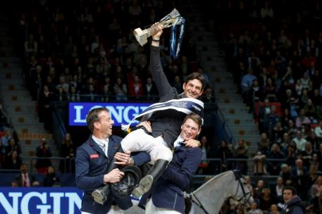 London 2012 Olympic champion Steve Guerdat of Switzerland is hosted aloft by runner-up Harrie Smolders (NED), left, and third-placed Daniel Deusser (GER), right after claiming victory in the Longines FEI World Cup™ Jumping Final in Gothenburg (SWE) today.