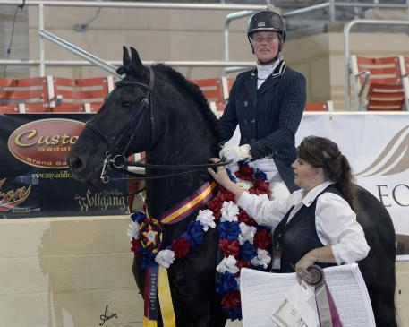 Susan Bouwman-Wind, riding Annette Coester's Jesse 435, wins the Custom Saddlery Most Valuable Rider (MVR) Award at the 2015 International Friesian Show Horse Association (IFSHA) World and Grand National Championship horse show