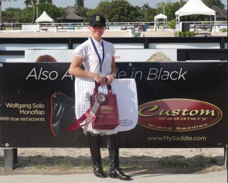 Susie Dutta wins the Custom Saddlery MVR Award at the 2016 Adequan Global Dressage Festival