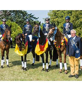 Germany's Hanna Knuppel, Romina Engelberth, Lara Schapmann and Johanna Zantop pictured with Chef d'Equipe Heinz Nothofer after winning the FEI European Eventing Championships for Juniors 2015 at Bialy Bor in Poland. Zantop also claimed the individual title. (FEI/Hanna Broms/EventingPhoto.com)