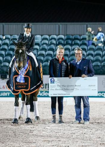 Tinne Vilhelmson-Silfven and Don Auriello pose with groom Angelica Karlson as she is presented the Groom's Initiative Award by Thomas Baur, Director of Sport at AGDF.