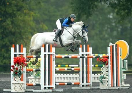Tracy Fenney and MTM Reve Du Paradis on their way to a $25,000 Brook Ledge Grand Prix win.