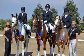 The winning Training Level Team of WR Dressage celebrate their win at the CDS Junior Young Rider Championships – Northern Region. From L-R: Manager Michele Vaughn, Haley Fava, Kendra Mitchell, Arianna Barzman-Grennan, and judge Joan Williams.  Photo by Jennifer M. Keeler.