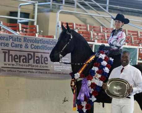 Bruce Griffin, TheraPlate Brand Ambassador, presents Tymo Fan de Stuken and rider Kassandra Sapia with the TheraPlate Peak Performance Award at the 2015 International Friesian Show Horse Association (IFSHA) World and Grand National Championship Horse Show