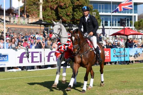 They used to call this dressage in Australia; riding one and leading one. Shane Rose completes his lap of honour riding second placed Virgil and leading the Four Star winner, CP Qualified.
