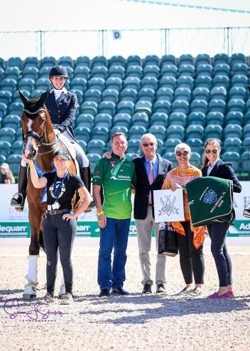 Olivia LaGoy-Weltz with Allyn Mann of Adequan®, 'Betsy' Juliano of class sponsor Havensafe Farm and judge Gabriel Armando.