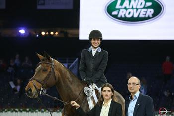 Canada's Wesley Newlands riding Evita van de Veldbalie is presented as the fourth-placed finisher in the €25,000 Land Rover Grand Prix on Sunday, December 6, at the Gucci Masters in Paris, France.