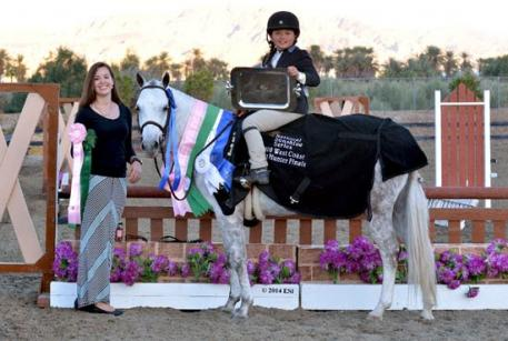 Asia Manning of HITS presents Augusta Iwasaki and Bit of Laughter with the $3,000 West Coast Pony Hunter Final awards, including the Cymraeg Rainshower Memorial Trophy.  (C) ESI Photography