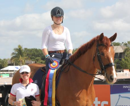 "Barbara ""Bebe"" Davis receives the Premier Equestrian Sportsmanship Award with her trainer Katie Riley of Piaffe Performance at the 2015 Adequan Global Dressage Festival."