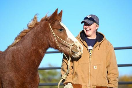 Becky Shady and Ruby, a horse that prior to working with Ray had never been handled.