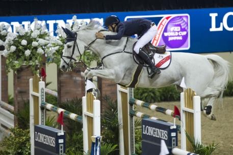 Ireland's Bertram Allen and the brilliant grey mare, Molly Malone, won the opening Speed competition of the Longines FEI World Cup™ Jumping 2015 Final at the Thomas & Mack arena in Las Vegas, USA. (FEI/Dirk Caremans)