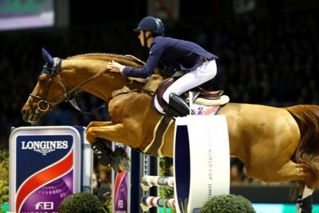 Ireland's Bertram Allen clinched his second victory in the Longines FEI World Cup™ Jumping 2014/2015 Western European League at Bordeaux, France tonight riding Romanov. (FEI/Pierre Costabadie)