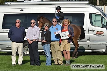 Gulf Coast Classic Company President Bob Bell, Lisa Engel and Foley RV Center's Ron Lester and representatives present Brennan with champion honors.