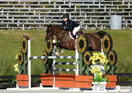 Callie Smith and Upstaire take the $5,000 Junior/Amateur-Owner Classic Medium at HITS Ocala. (C) ESI Photography