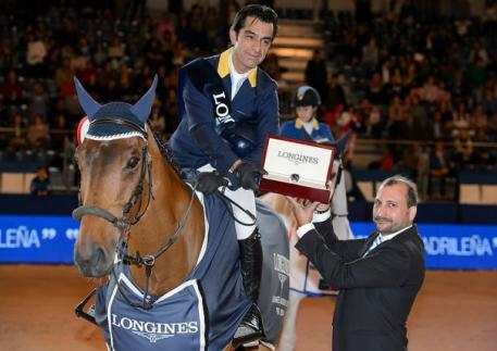 Colombia's Carlos Lopez, winner of the sixth leg of the Longines FEI World Cup™ Jumping 2014/2015 Western European League in Madrid, Spain today, pictured with his winning horse, Prince de la Mare, and Longines Brand Manager for Spain, Miguel Angel Palmer.  (FEI/Herve Bonnaud).