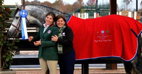 Carrasca Z poses with Taylor and Janet Flury after scoring a perfect 10.