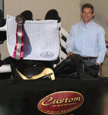 Custom Saddlery's Cary Wallace prepares to present the Custom Saddlery Most Valuable Rider Award at the 2015 Adequan Global Dressage Festival
