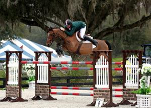 Charlie Jayne and Playboy jump to victory in the $25,000 SmartPak Grand Pri. (c) ESI Photography