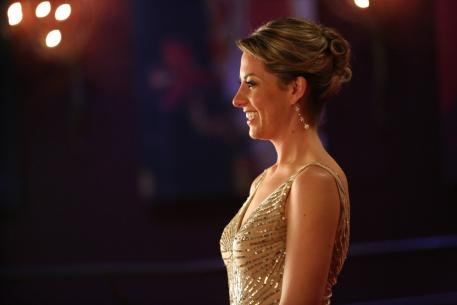 Charlotte Dujardin, the double Olympic gold medallist and world Dressage number one, is pictured at the FEI Awards 2013 ceremony in Lausanne (SUI), where she collected her Reem Acra Best Athlete award dressed in a stunning Reem Acra creation. (FEI/Anthony Demierre)