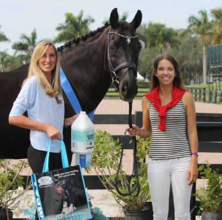 Chase Hickok (right) and Sagacious HF accept the Omega Alpha Healthy Horse Award from Krystalann Shingler (left) at the 2015 Adequan Global Dressage Festival