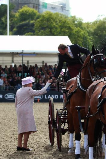 HRH Queen Elizabeth congratulates Chester Weber on another four-in-hand win at the Royal Windsor Horse Show (Photo: Risto Aaltonen)