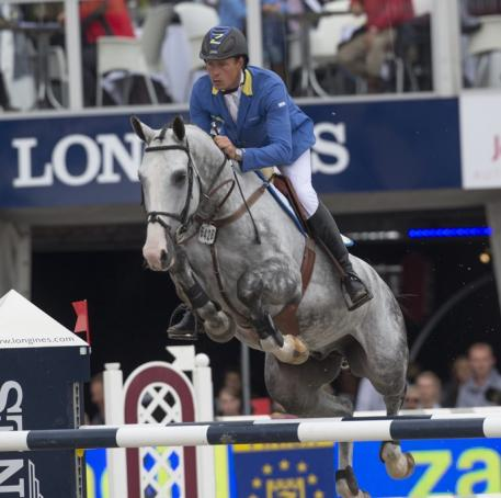 Germany's Christian Ahlmann steered the Westphalian gelding, Hui Buh, to victory in the six-year-old category at the FEI World Breeding Jumping Championships for Young Horses 2014 at Lanaken in Belgium today. (FEI/Dirk Caremans)