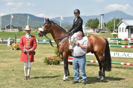 Christine McCrea receives the Richard and Diana Feldman Perpetual Challenge Trophy for Excellence (Photo: The Book LLC)