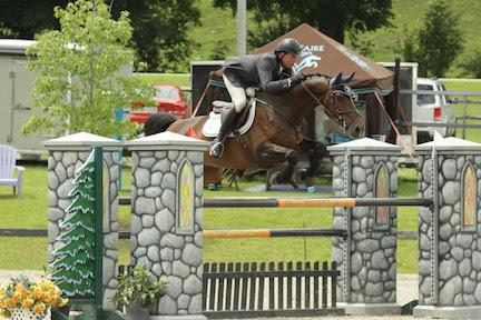 Cory Hardy and Camelot 105 on their way to victory in the $5,000 1.40m Open Jumper on July 22 at the Vermont Summer Festival in East Dorset, VT. (Photo: David Mullinix Photography)