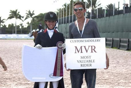 Kasey Perry (left) wins the Custom Saddelry Most Valuable Rider Award at the 2015 Adequan Global Dressage Festival.