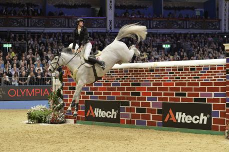 David Simpson jumps to victory on his gallant mare Richi Rich to win the Alltech Christmas Puissance at Olympia, London. Credit: Kit Houghton.
