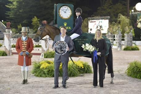 Ringmaster Alan Keely, along with Patrick Corridon and Mary Murphy of PwC, present to the winners Lucy Deslauriers and Hester. Photo Credit Kit Houghton/Rolex