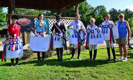 Division Champions at the Dressage4Kids 2015 Atlanta Youth Dressage Festival win Custom Saddlery saddle pads (Photo: Marc Mesa)