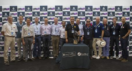 Spain's Marco Fuste (centre) is joined by the 13 other Chef d'Equipes whose teams will line out tomorrow at the Real Club de Polo in Barcelona, Spain when the Furusiyya FEI Nations Cup™ Jumping Final 2014 gets underway. (FEI/Dirk Caremans)