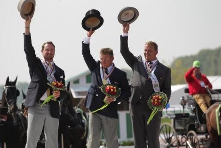 The individual Driving medallists in the Alltech FEI World Equestrian Games™ 2014 in Normandy. Pictured from left to right are silver medallist Chester Weber (USA); gold medallist and world champion Boyd Exell (AUS); bronze medallist Theo Timmerman (NED). (Marie de Ronde-Oudemans/FEI)