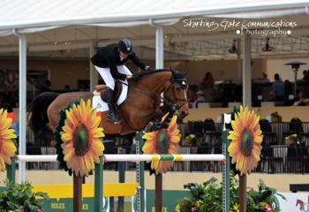 Eric Lamaze and Rosana du Park, owned by Artisan Farms LLC and Torrey Pines Stable, won the $25,000 Ruby et Violette WEF Challenge Cup Round I on January 8 at the 2015 Winter Equestrian Festival in Wellington, FL. Photo by Starting Gate Communications