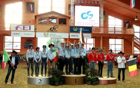 The Junior Team podium at the FEI European Reining Championships for Juniors and Young Riders 2015 at Givrins, Switzerland (L to R): the silver medallists from Italy, gold medallists from Germany and bronze medallists from Belgium. (FEI/Andrea Bonaga)