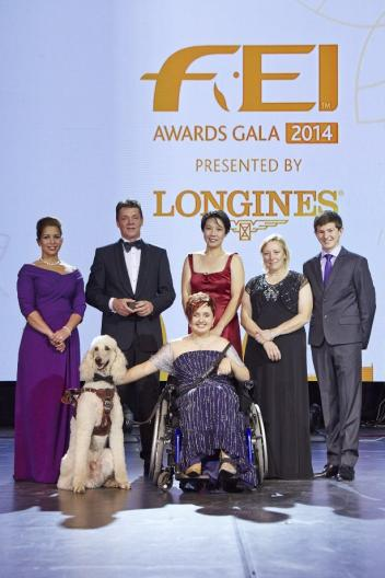 """Equestrian heroes were celebrated tonight at the glittering FEI Awards 2014, the """"Oscars of the equestrian world"""", presented by Longines in Baku's fabulous Buta Palace (left to right): HRH Princess Haya, Jeroen Dubbeldam (NED), Melissa Tan (SIN) chairman of equine therapy centre Equal Ark, Jackie Potts (GBR), Lambert Leclezio (MRI) with (centre) Sydney Collier (USA) and her service dog Journey. (FEI/Liz Gregg)"""