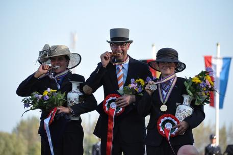 (centre) Wilbrord van den Broek (NED) won individual gold at the FEI World Single Driving Championships 2014 in Izsák (HUN) with Germany's Claudia Lauterbach taking silver (left) and compatriot Marlen Fallak claiming bronze. (Claudia Spitz/FEI).