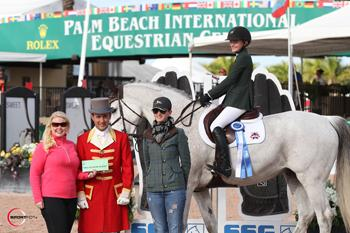 "Giavanna Rinaldi riding G.P.S. Brilliant Disguise, pictured with SSG Gloves ""Go Clean for the Green"" promotion manager Jennifer Ward, ringmaster Gustavo Murcia and trainer Haylie Jayne, is presented with a ,000 bonus in the SSG Gloves ""Go Clean for the Green"" promotion after winning the 0,000 Sleepy P Ranch High Junior Jumper Classic on February 8. Photo by Sportfot"