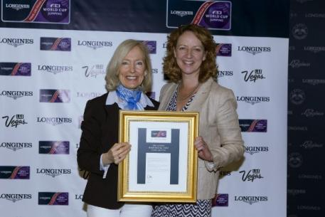 FEI Director of Press Relations Grania Willis presents Jo Peck, press officer for the London International Horse Show, Olympia, with the Best Press Office award for the Longines FEI World Cup™ Jumping Western European League 2014/2015 at the Longines FEI World Cup™ Jumping Final in Las Vegas (NV). (Photo: Dirk Caremans/FEI)