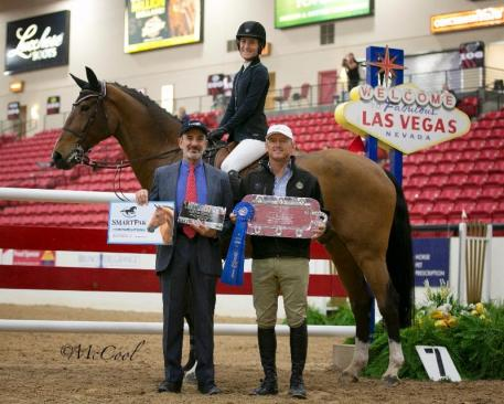 Show Jumping Hall of Fame Executive Director Marty Bauman & Olympic Gold Medalist and Hall of Fame Board member Will Simpson present the award to Hannah Von Heidegger (c)Amy McCool
