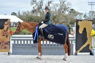 Hasbrouck Donovan and Cymplify win the blue in the 0,000 Devoucoux Hunter Prix at HITS Ocala Week VIII Saturday, March 7, 2015. (Photo:ESI Photography)
